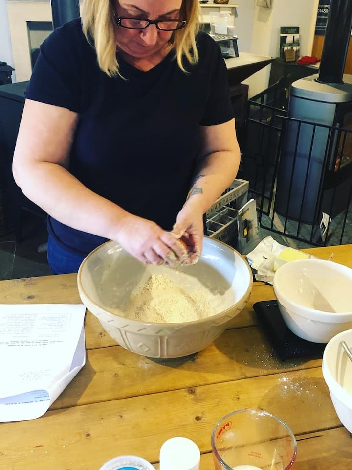 A guest mixing the signature scones