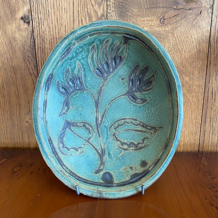 A plate remade with a simple plant motif