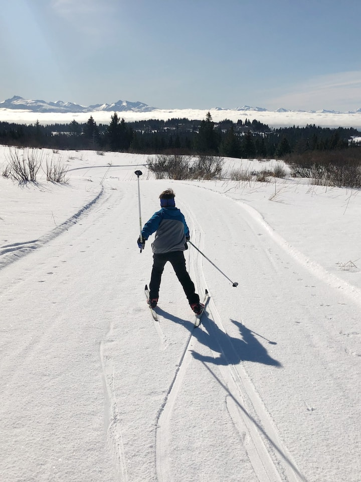 A young skier skating down the trails