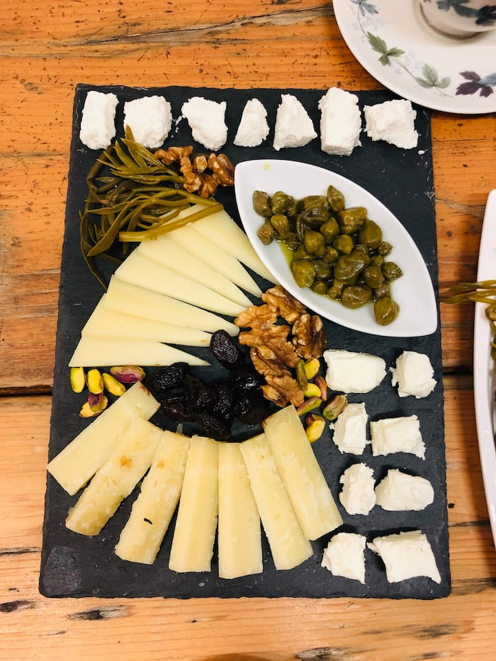 A cheese, nuts and pickles board