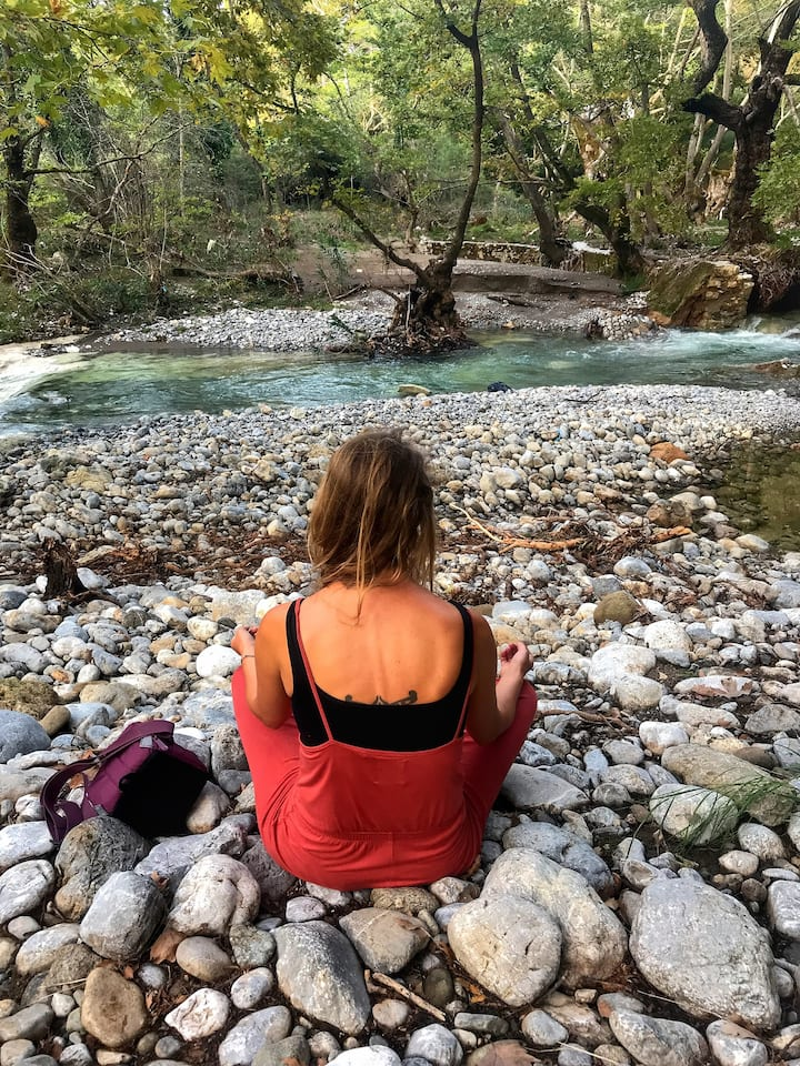 Taking a break to meditate by the river