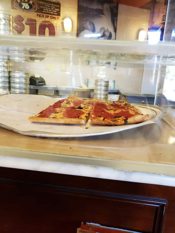 slice of pizza included at pier 76