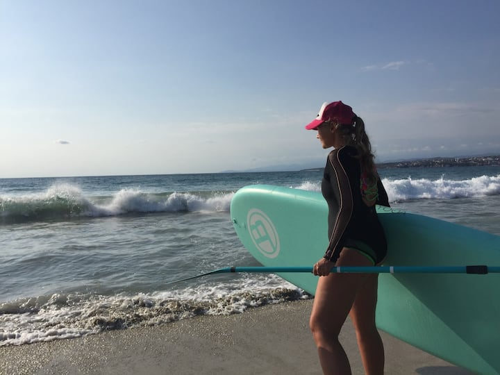 Kelly-Ann launching at La Punta in surf