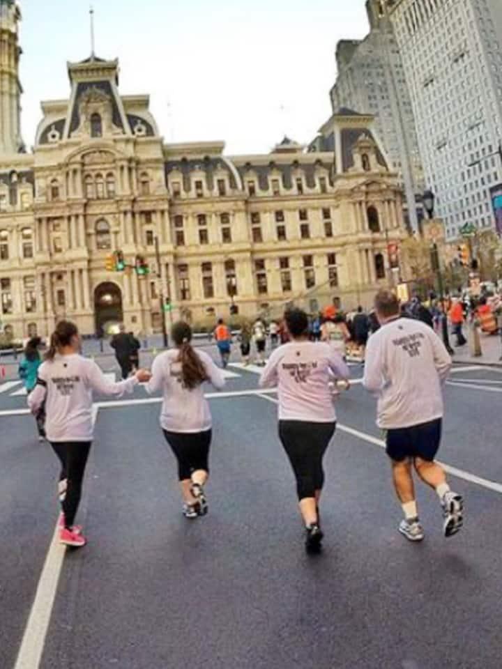 Group running toward City Hall
