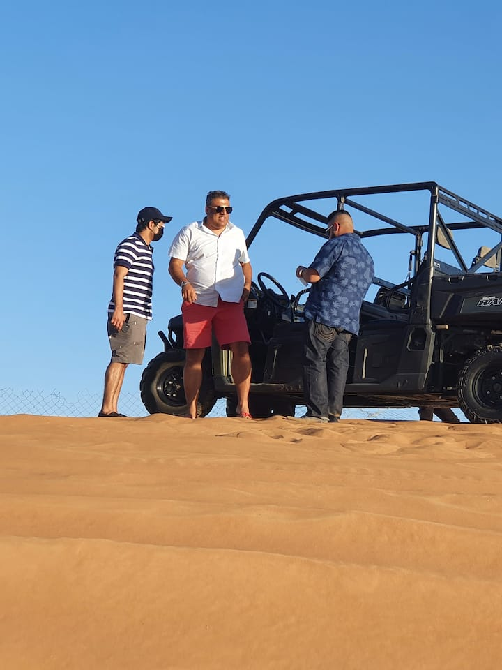 Group buggy ride red dunes