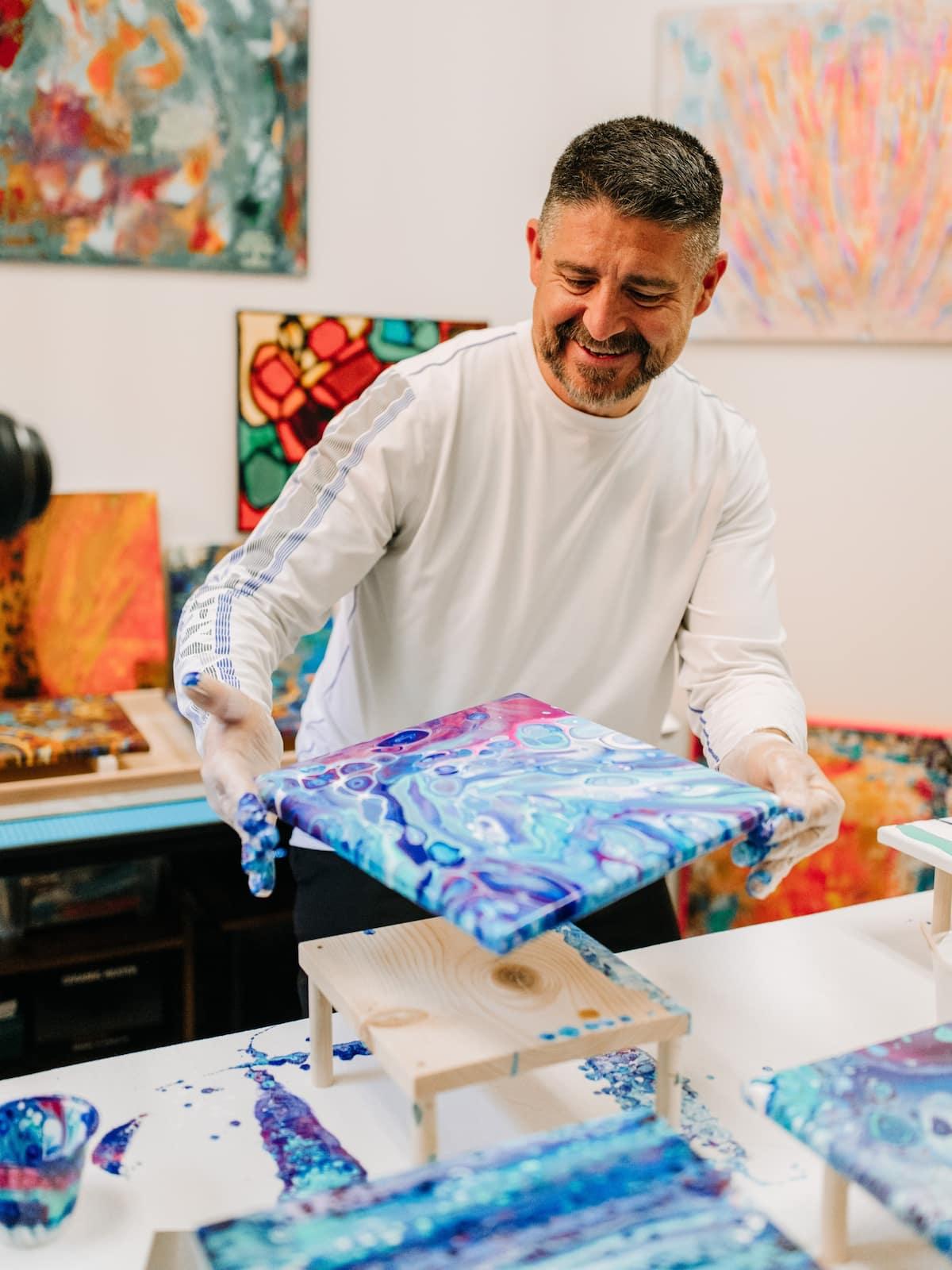 Man making acrylic art