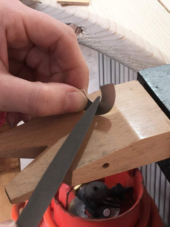 Filing on the bench peg