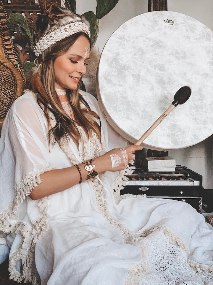Anna playing the drums during meditation