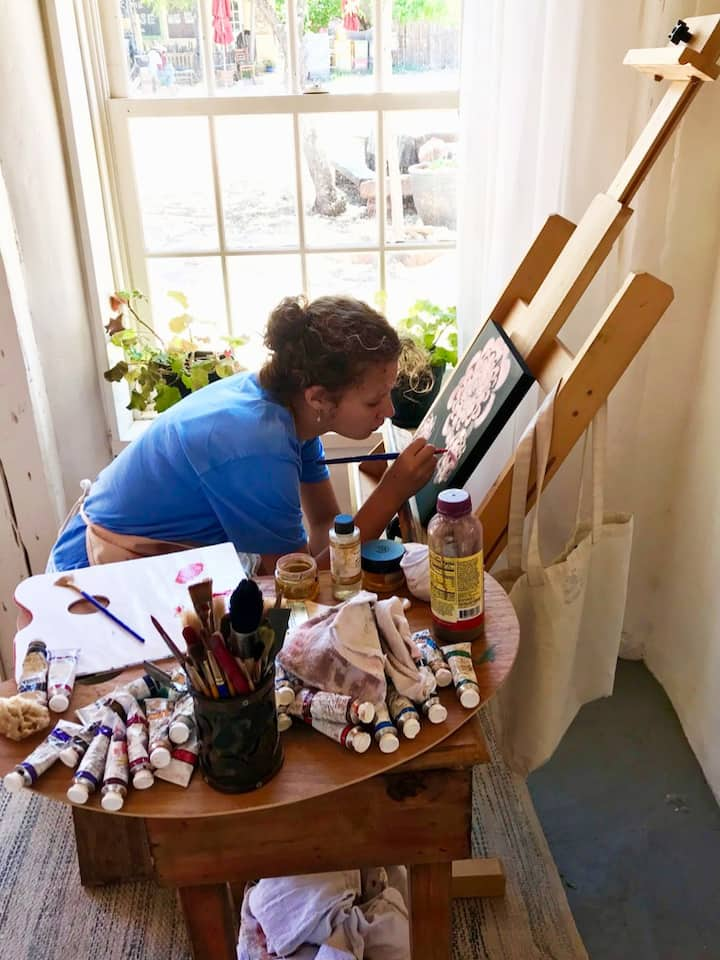 Guest working on their painting