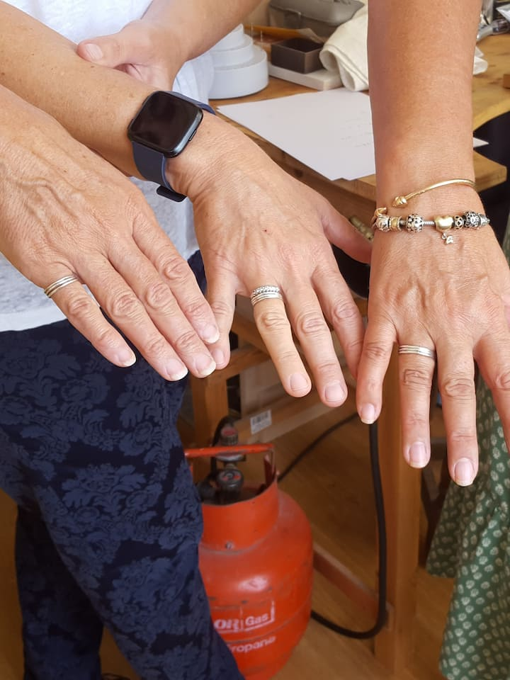 Three friends showing their rings!
