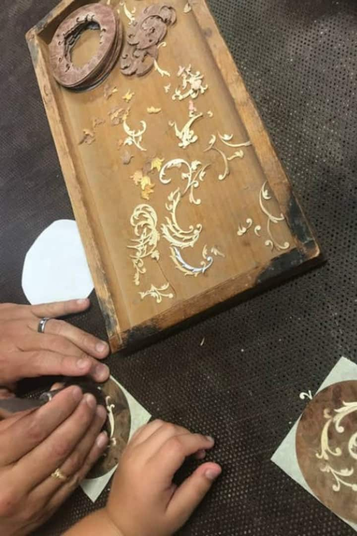participation in the creation of inlay