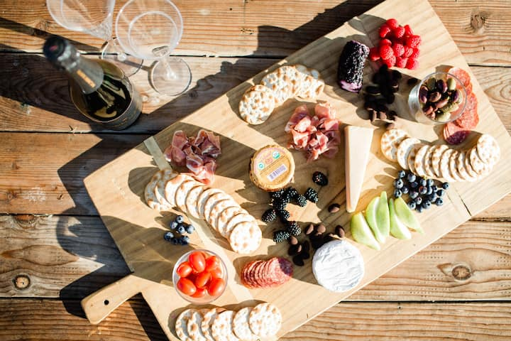 Champagne and a charcuterie is provided.