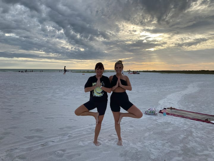 Mom and daughter yoga team