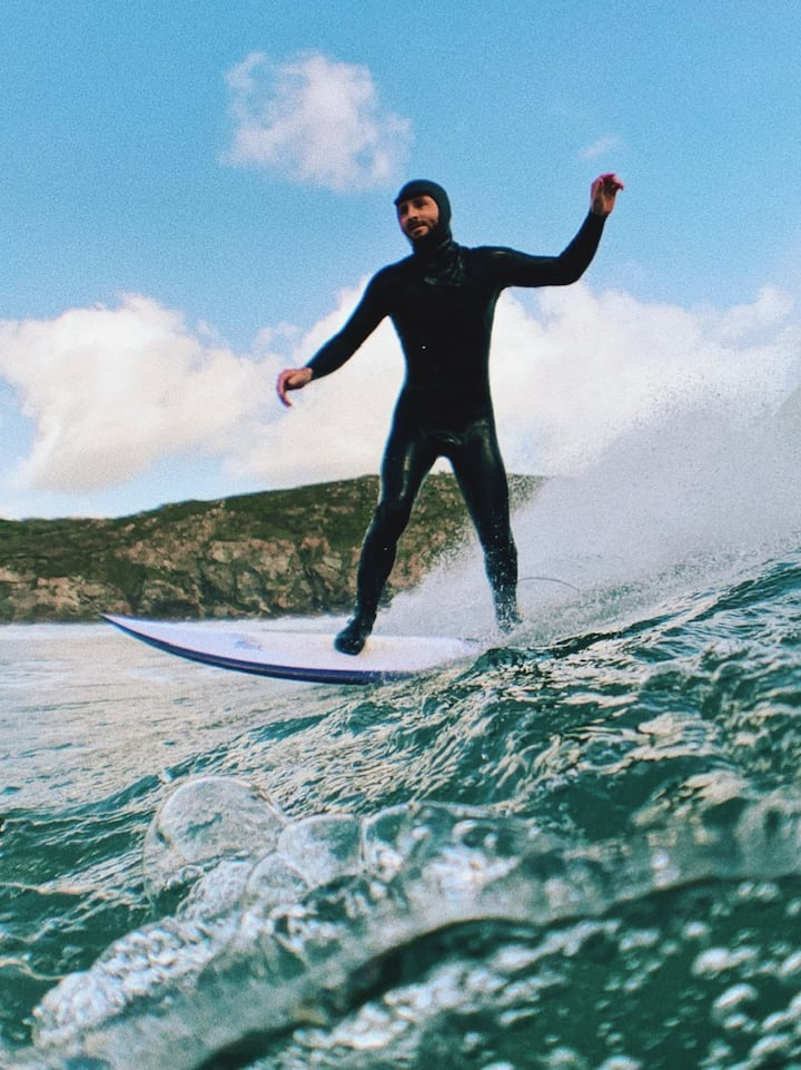 Surfer, secret beach, Cornwall