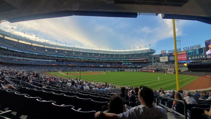 Folks enjoying an evening Yankees game