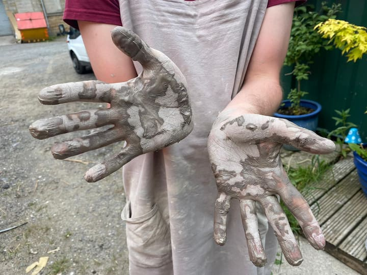 Messy clay hands