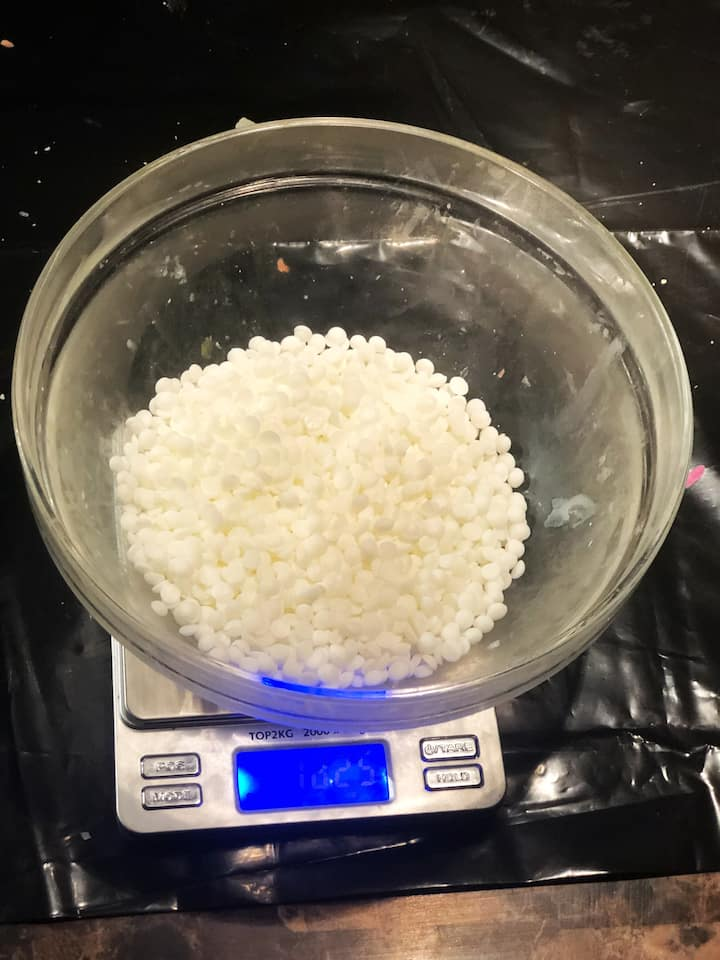 Now it is time to weigh out your wax. I have found, that with soy shavings or pebbles, the amount in weight is approximately .50 oz over the volume in oz. It is important to weigh out the wax properly so that you don't end up wasting materials.