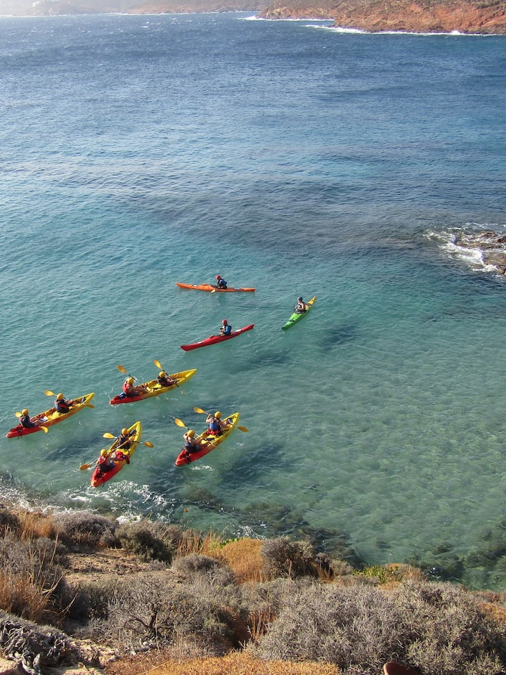 Morning paddle in the sheltered bay of Kiki's Beach