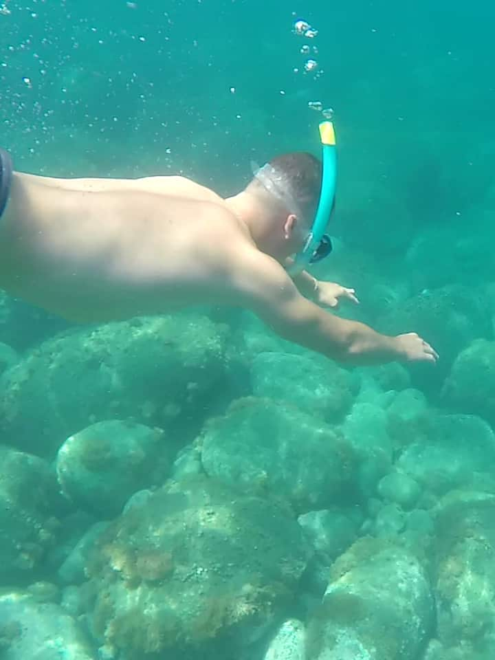 Snorkeling with many fish