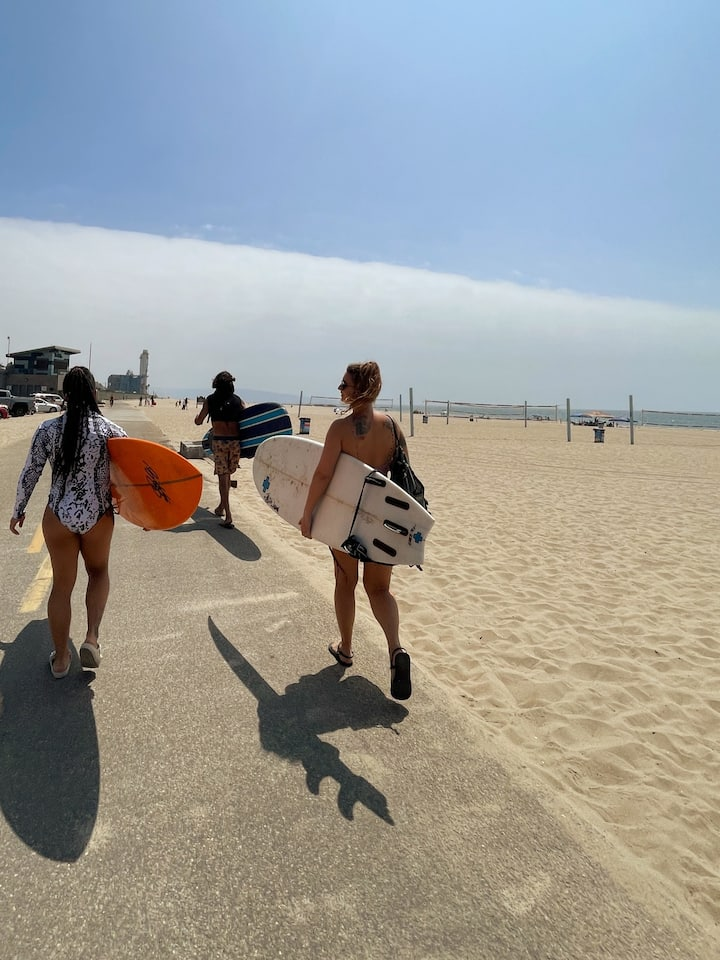 Heading down the beach path to our perfect beginner beach break for lessons.