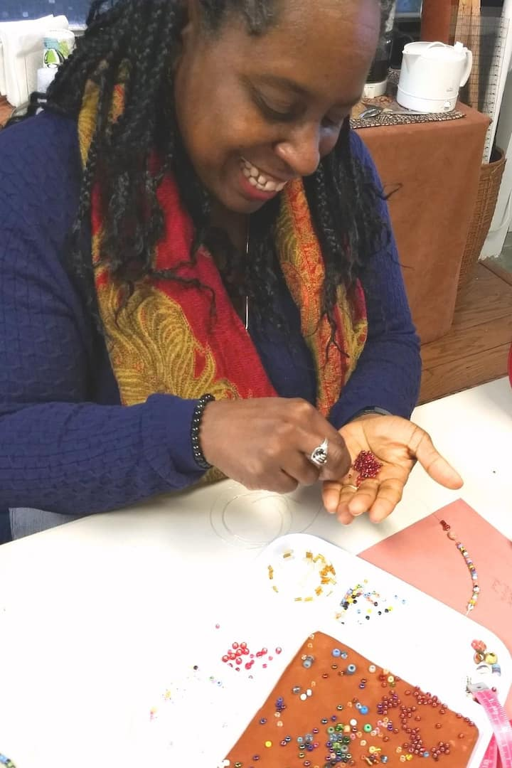Participant stringing beads