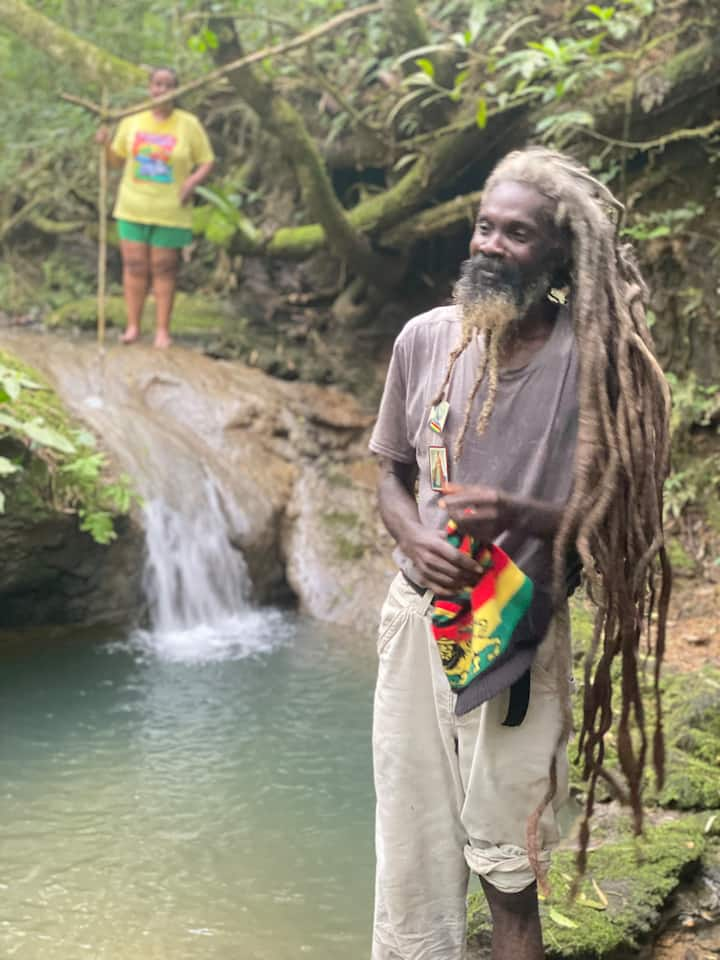 Vin (Rasta Man) introducing his natural mineral springs with pool