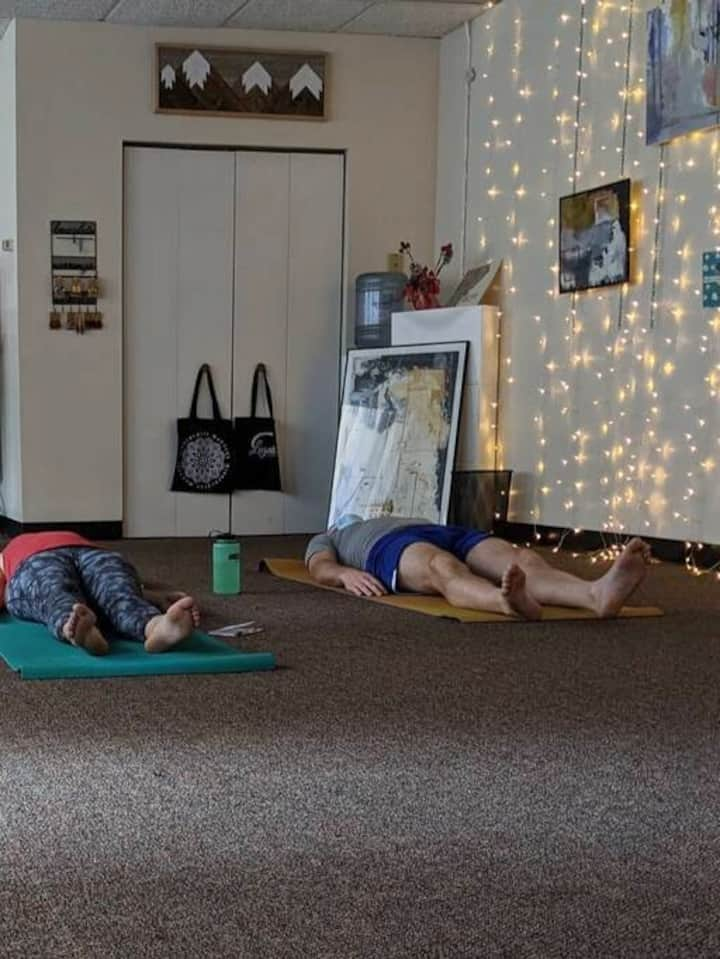 Students in Savasana after guided meditation at Legato Collective.