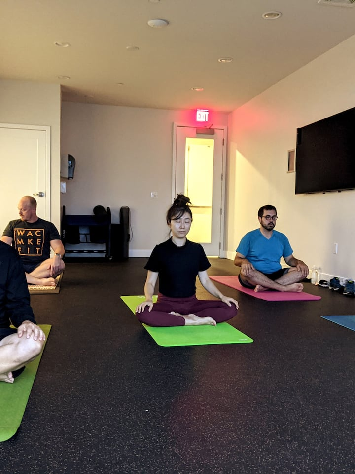 Students in easy seated pose before we move into our restorative yoga class.