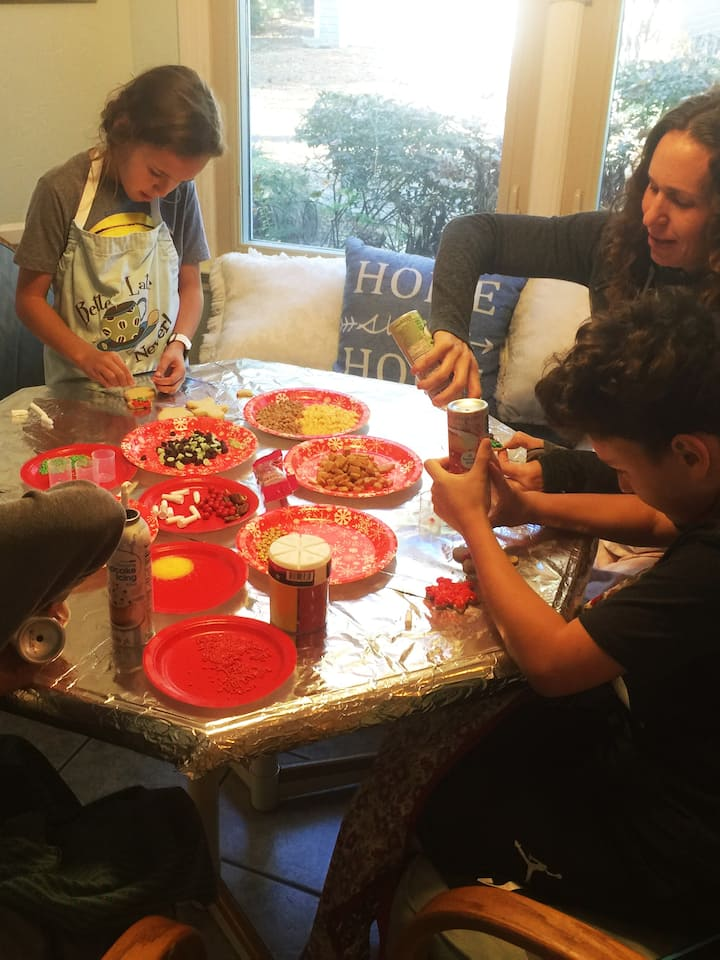 Children and Mom  decorating Cookies