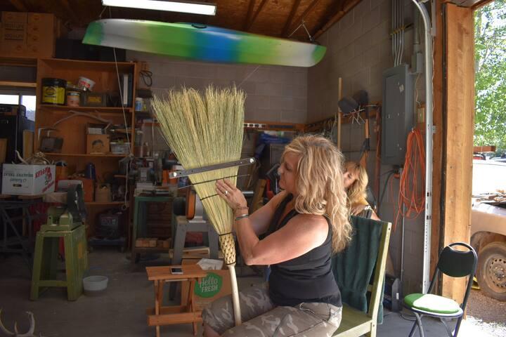 Stitching the broom.