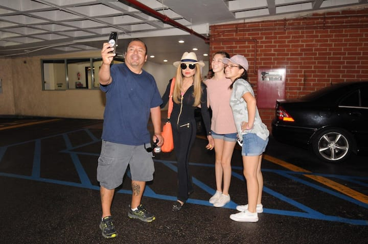 LaToya Jackson stops for a selife
