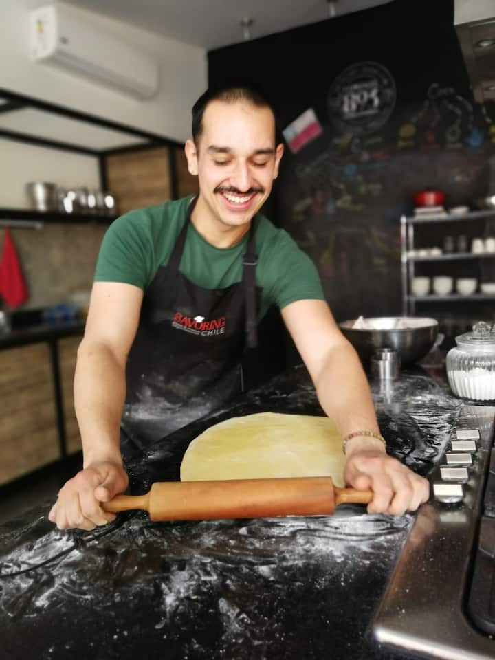 Gerardo rolling the dough.