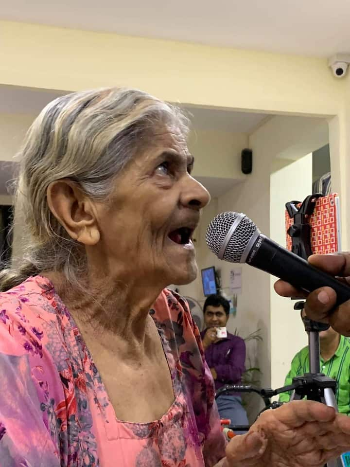 Helping an old senior citizen to sing