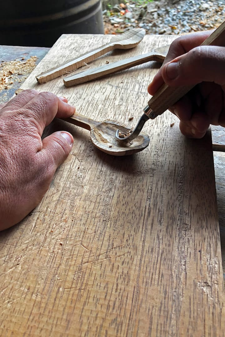 A spoon being carved
