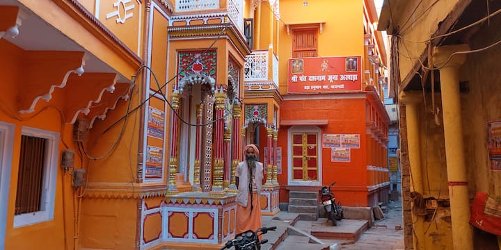 A Sadhu standing in front of his Ashram.