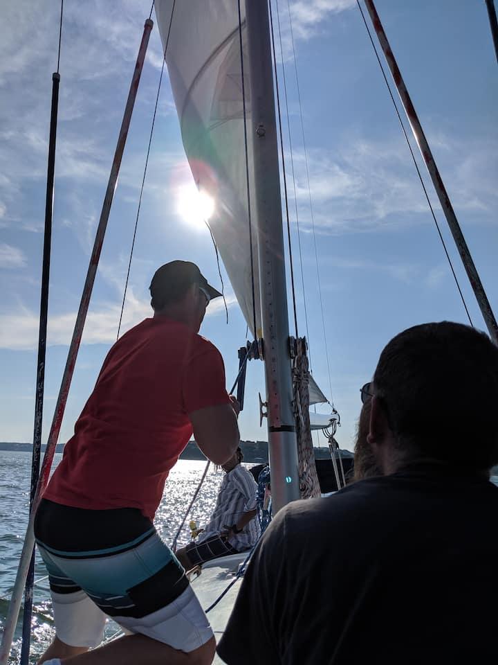 Captain hoisting the sail
