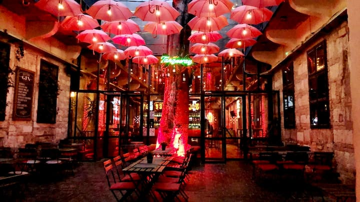 One of the Patios with red umbrellas