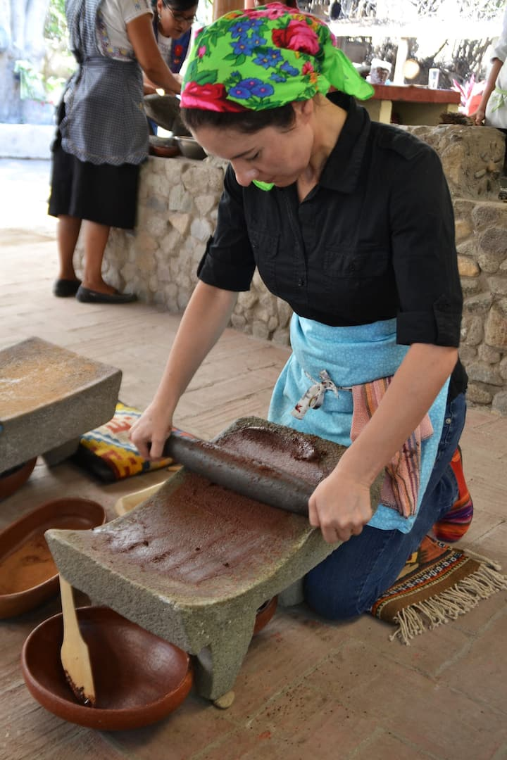 Making chocolate on a metate