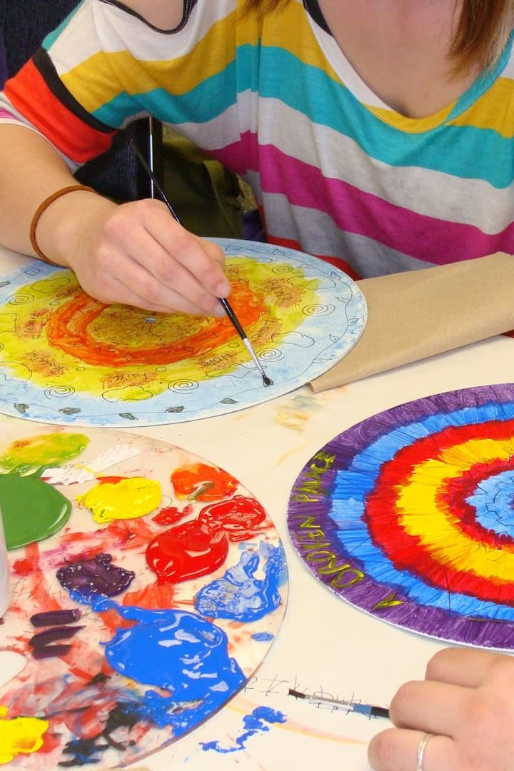 Middle school students painting mandalas