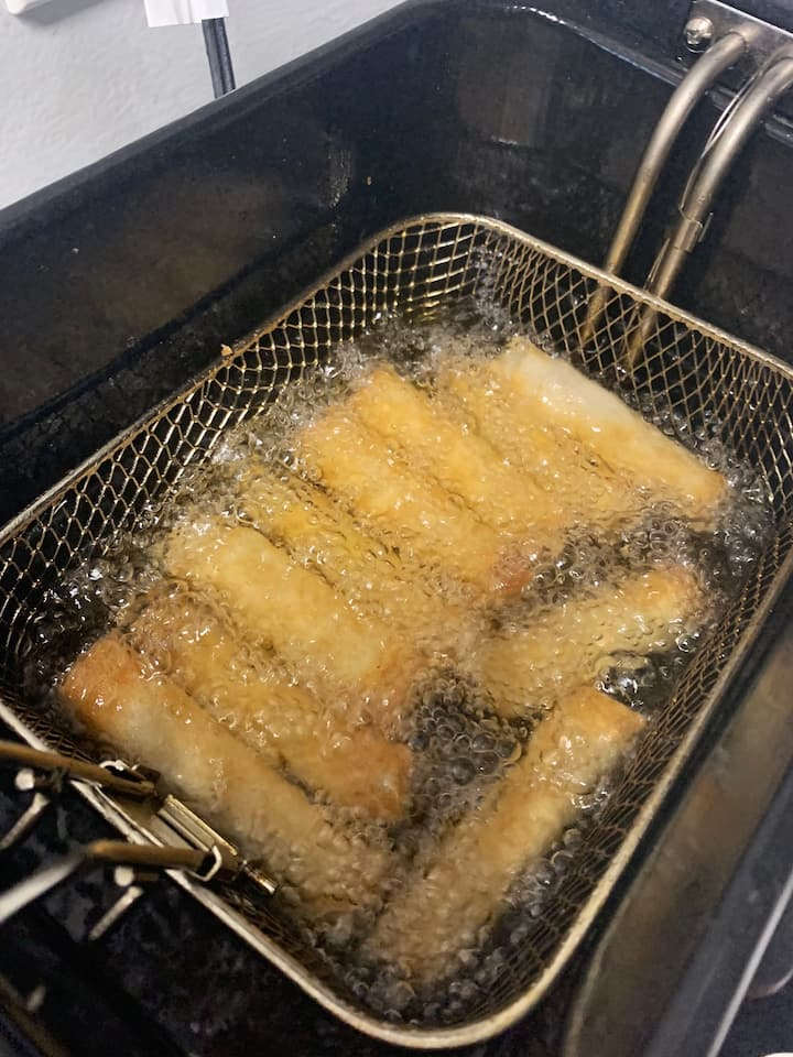 Lumpia cooking in the vegetable oil.