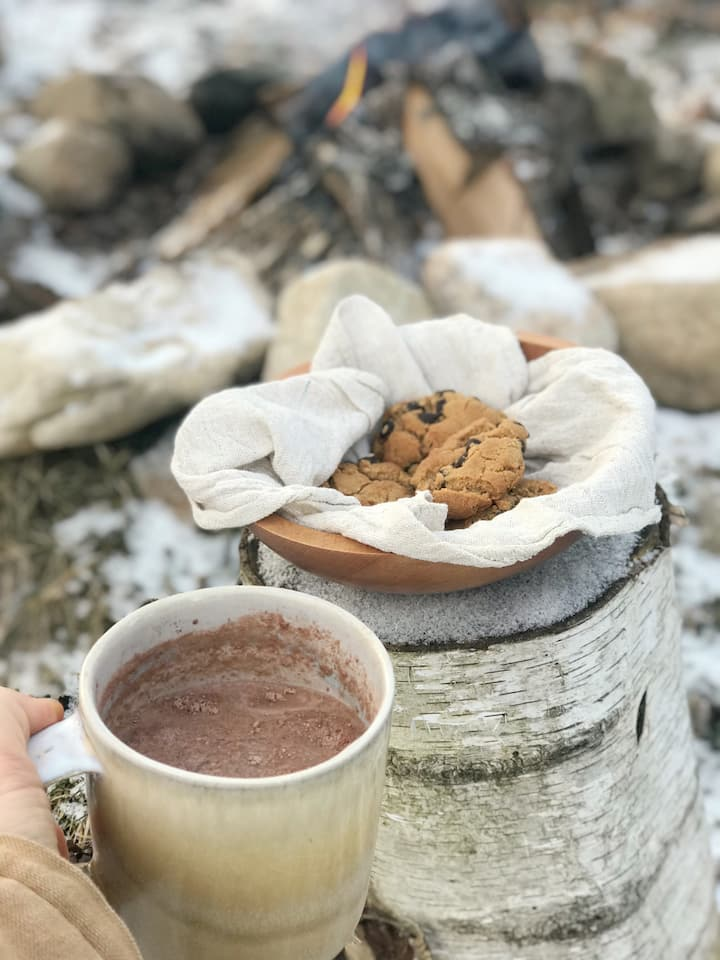 hot chocolate and treats by the fire