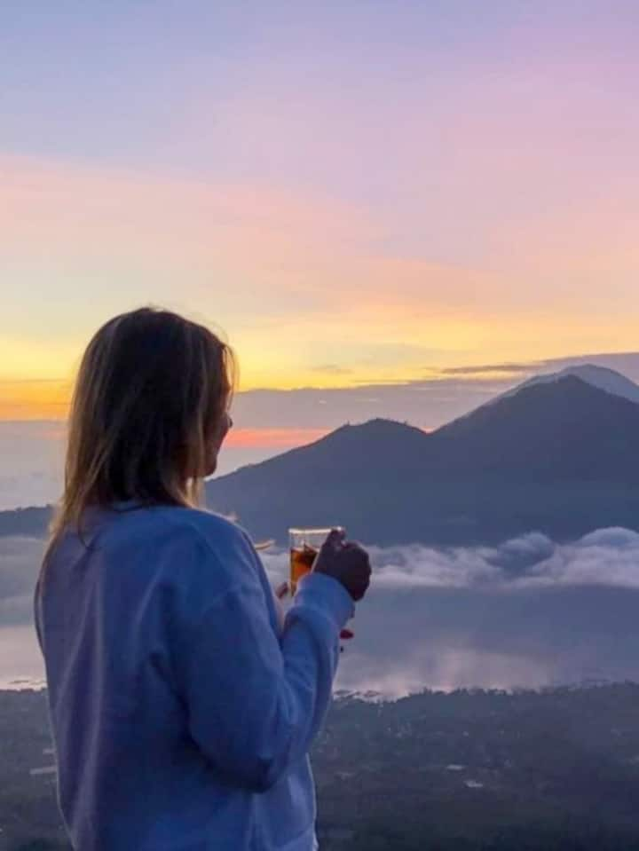 Enjoy sunrise with cup of coffee