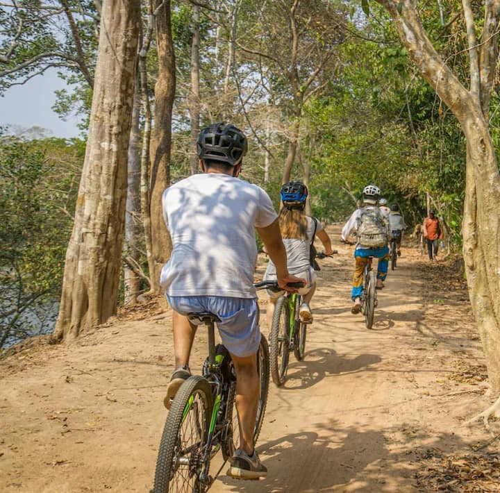 Cycle through the jungle of Angkor park