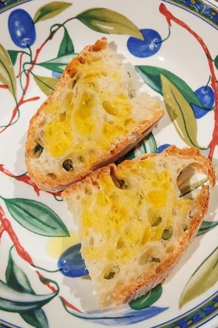 tasting  olive oil on bread