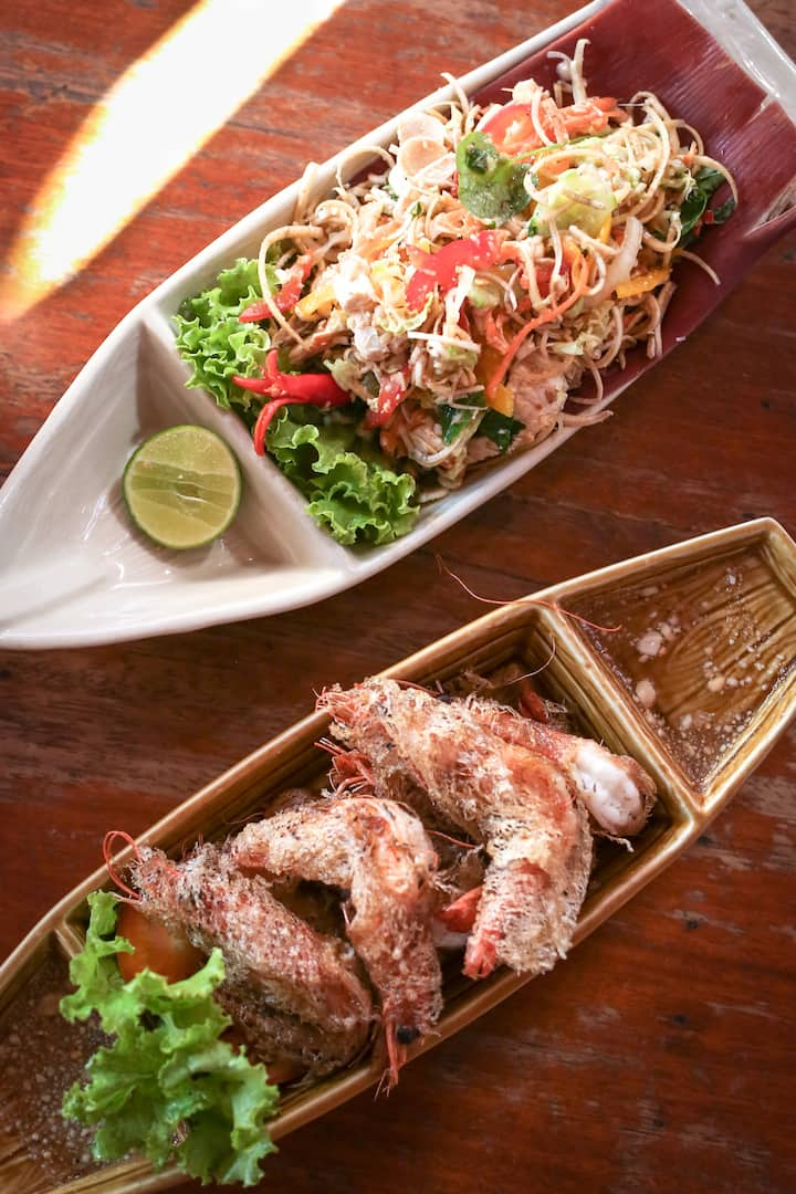 Mekong river dishes served in boat plates