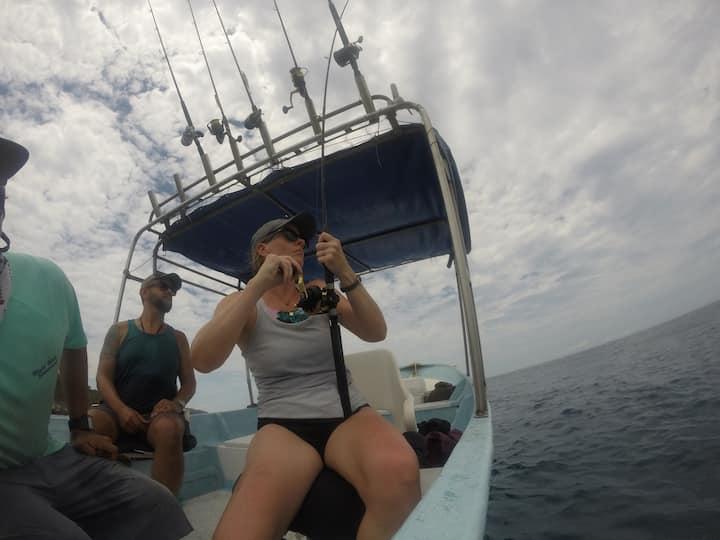 Lindsay reeling a fish