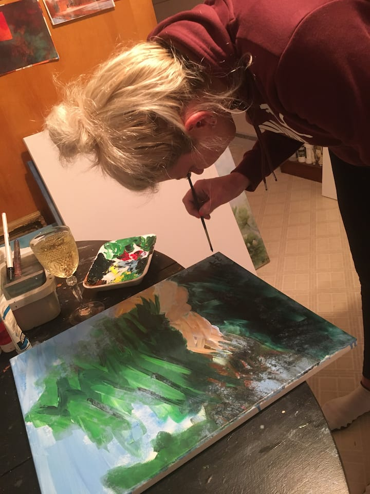 Guest enjoying her painting experience.