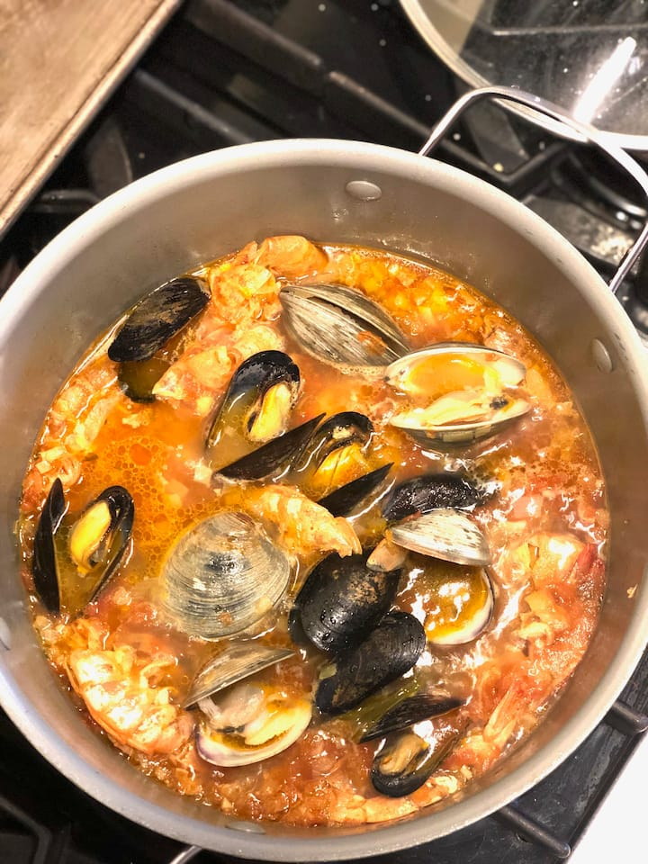 Simmering mussels & clams for cioppino