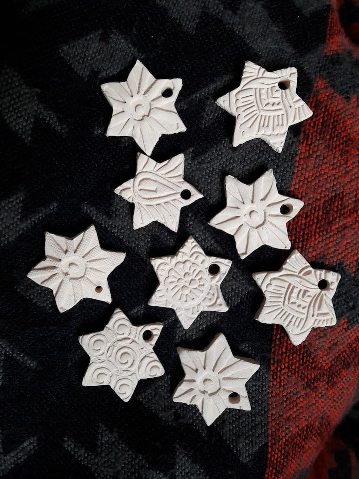 Hardened clay stars ready for painting