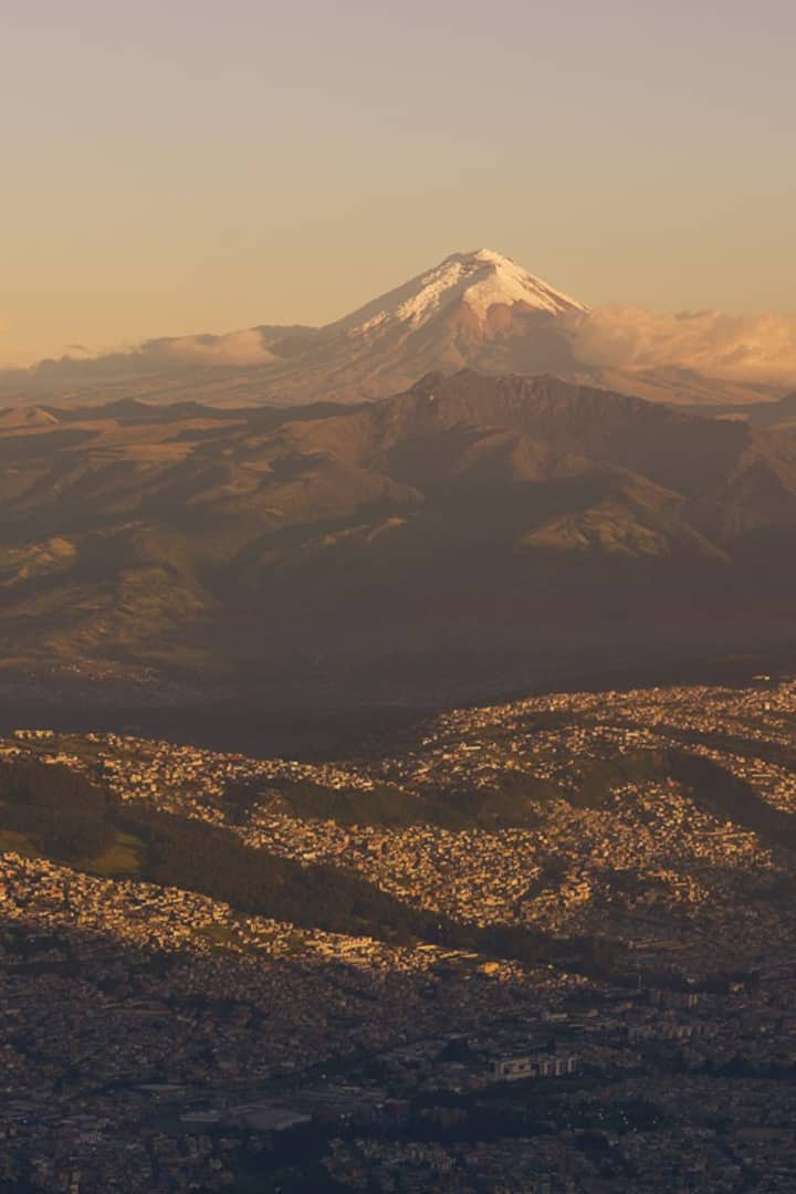 Quito, surrounded by active volcanoes,.